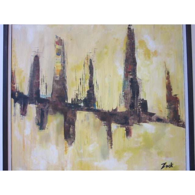 A cityscape painting from the Mid Century period with primary yellow tones signed to the front by artist Susan Zuck titled...
