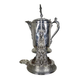 Tilting Silver Pitcher on Stand For Sale