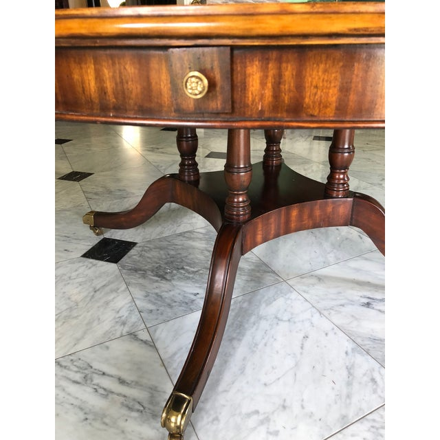 Regency style mahogany table with tooled embossed leather top. This is a modern reproduction by Maitland-Smith. Without...