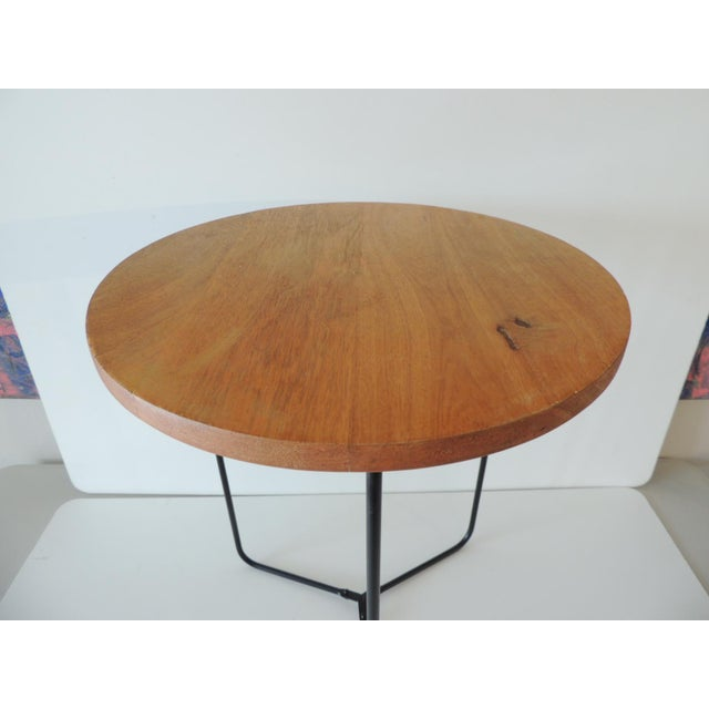 "Folding Round Side Table with Wood Top and Pencil Legs. Clip on top. Size: 14.5""D x 18.5""H"