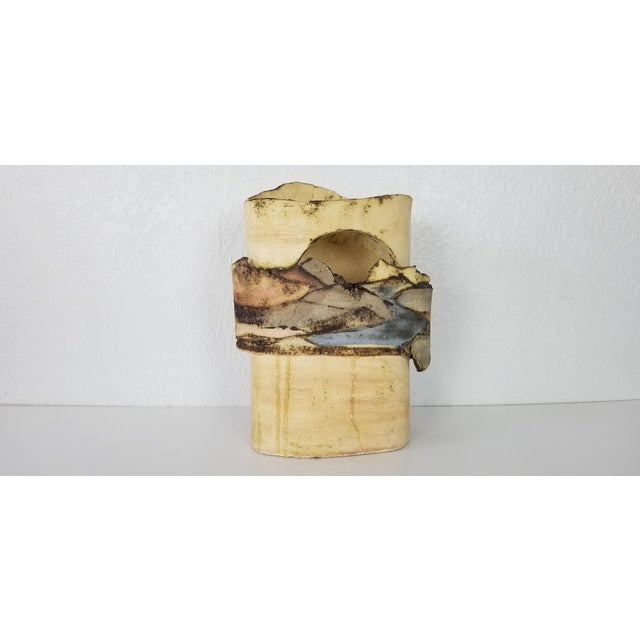 Available for sale is a stunning mid-century modern handmade Sculptural Art Pottery with Landscape Motif. Beautiful...