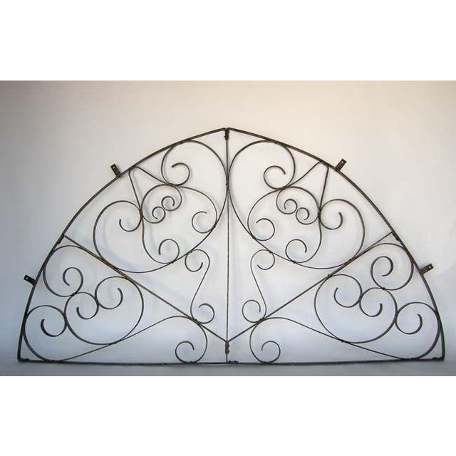 19th c. large iron architectural fragment with scroll work. Was originally used as a window grill in Guatemala. Has...