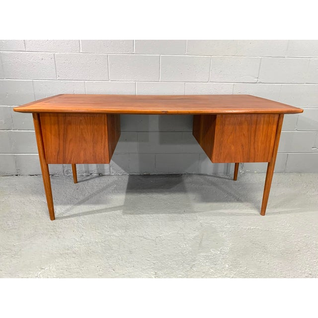 Nicely crafted danish modern, mid-century desk with floating top and hanging case design with round teak drawer pulls...