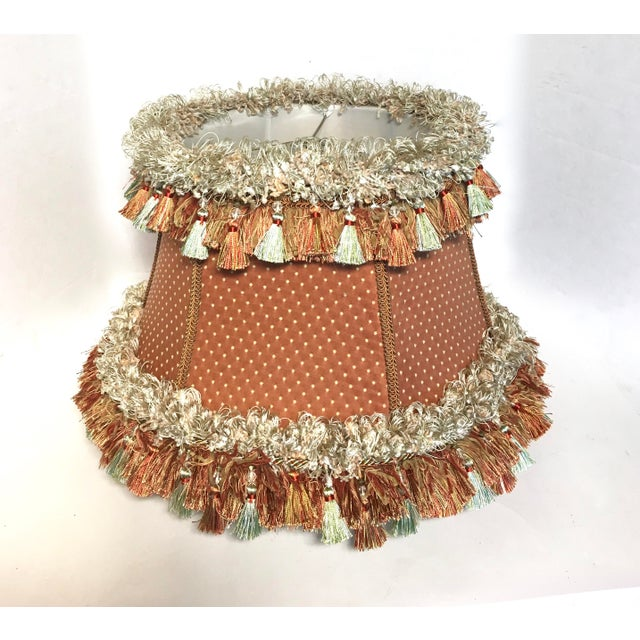 Embellished custom designer coral colored lamp shade with tassel trim. Lovely lamp shade that would look fantastic on lamp...