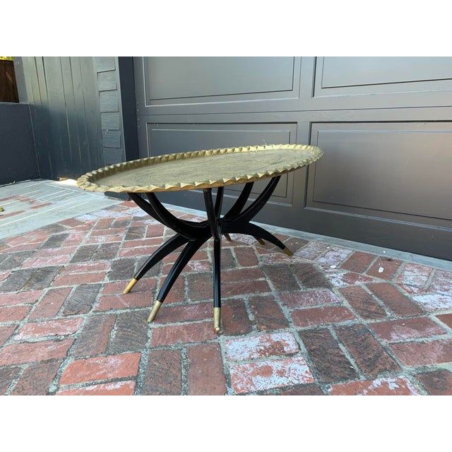 Mid Century Modern Morrocan Two Piece Brass and Ebony 6 Legged Sipder Oval Coffee Table For Sale - Image 4 of 6