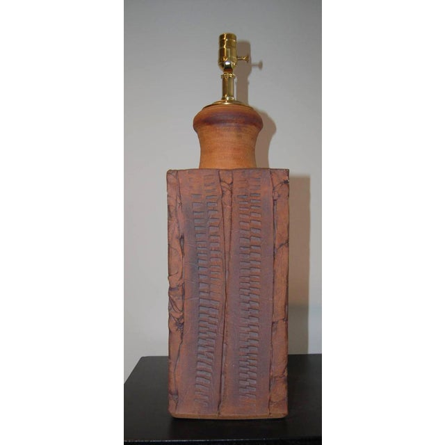 Large rewired lamp signed Wishon-Harrell in a natural terracotta color. Amazing detailing. Brass/Clay.