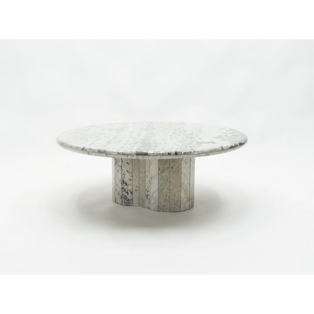 Unique vintage coffee table made in France in the early 1970s from a beautiful sicilian white marble. The thick surface of...