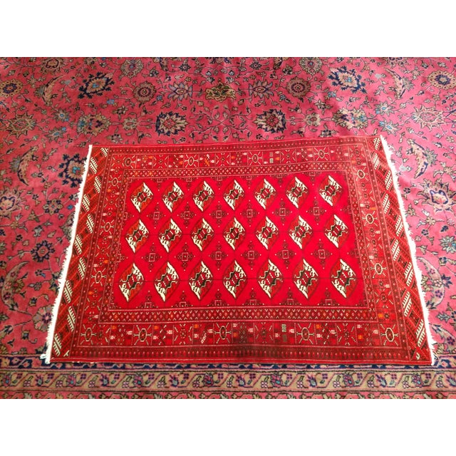 """Turkmen carpet with a traditional small star medallion design covering the field in the """"signature"""" red color of Turkmen..."""