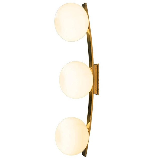 Italian Murano wall sconce shown in glossy light gray Murano glass pebbles on curved polished brass frame, designed by...