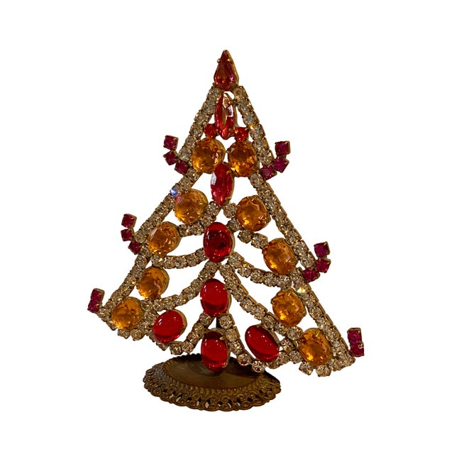 A Czechoslovakia rhinestone Christmas tree with beautiful red, silver and gold crystals in various sizes. Some forming the...