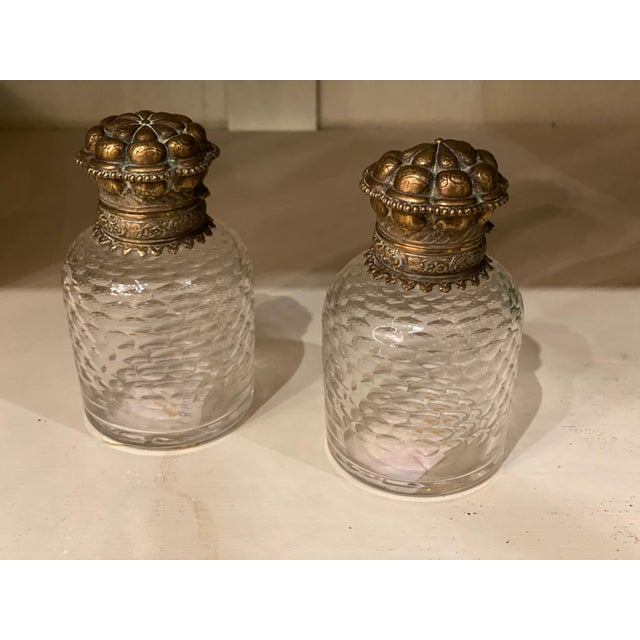 """Pair of 19th century bronze and glass inkwells with stoppers from France. 2.75"""" Diameter x 4.5"""" High"""