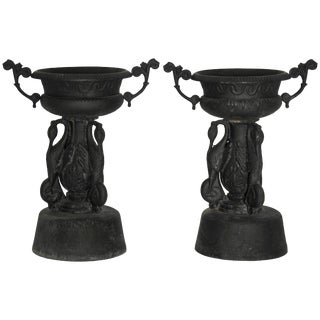 Pair of Cast Iron Garden Urns With Cranes For Sale