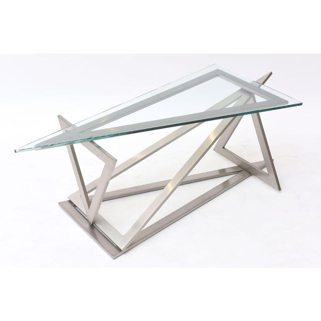 the triangular glass top above a series of stainless triangles connected in a sculptural form