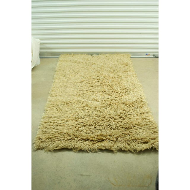Vintage Greek Flokati rug, 100% hand-woven sheep's wool in a rare chai color. Pristine condition, never walked on.