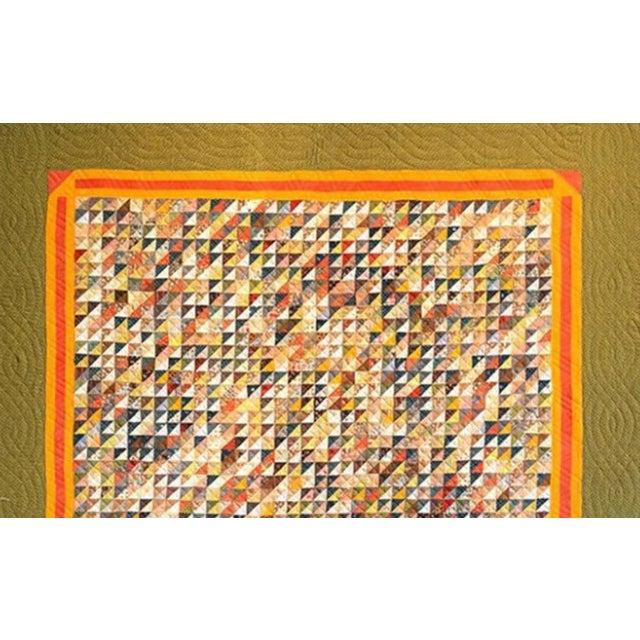 Monumental micro triangular cut feed sack folk art quilt mounted on canvas.