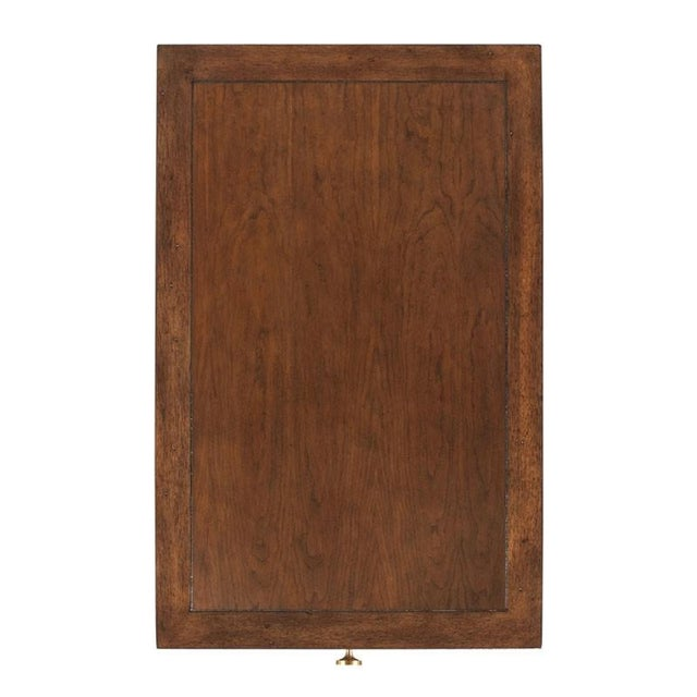 A handy table for drinks to have at your chairside with a rectangular framed top over an apron rail drawer elevated on...