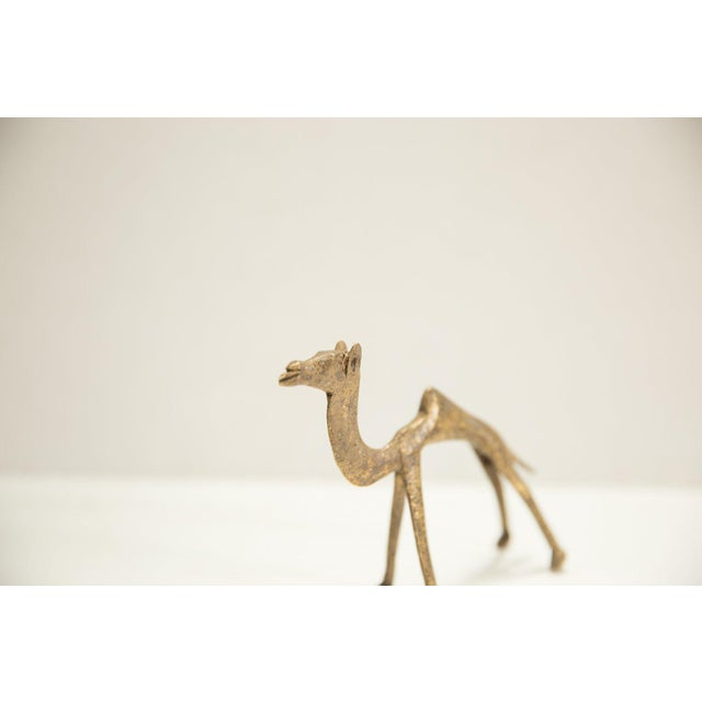 :: Vintage circa mid 20th century African bronze casting of a camel. This piece is unique and a great collectible. Ashanti...
