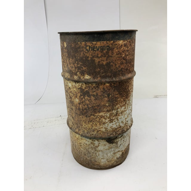 """VINTAGE OIL BARREL. Piece is a """"Chevron"""" brand. Nice brown rustic metal piece. Measures approx 27"""" tall x 14 1/2""""..."""