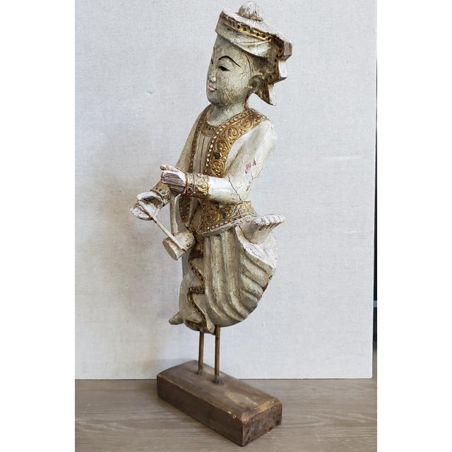 A vintage wood sculptural statue figure from Thailand measuring over 2 feet in height. The wood is hand carved and painted...