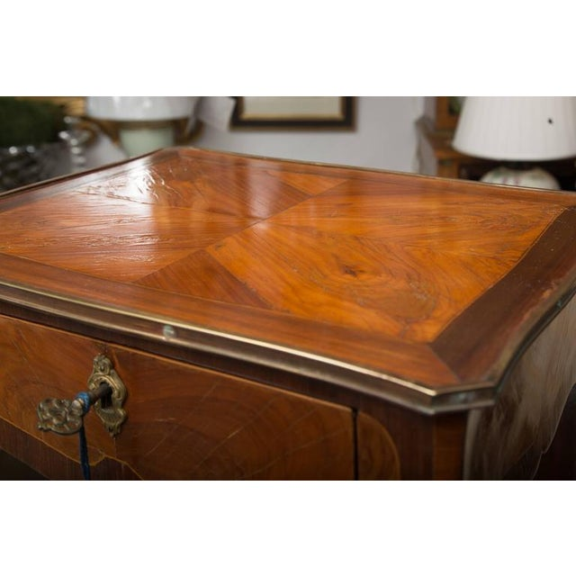 Small, but elegant, aptly describes this beautiful kingwood and rosewood Louis XV style side table. The top is banded with...