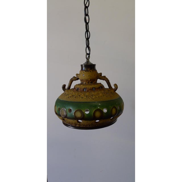 Brutalist Organic Modern Mid-Century Danish ceramic pendant light from the 1960s. With piercing and white underside. No...