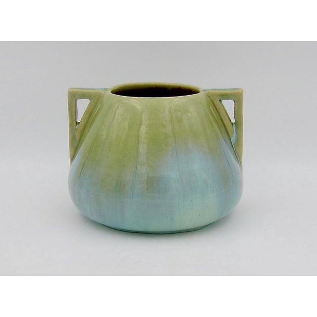An early 20th century vase from the Arts & Crafts period by Fulper Pottery of Flemington, New Jersey. This art pottery...