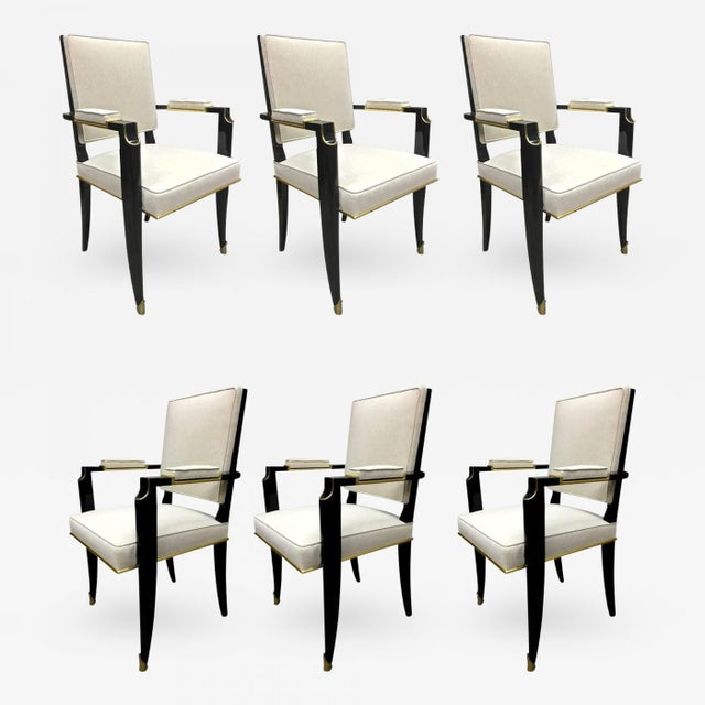MAURICE JALLOT set of six chicest black neoclassic chairs with gold bronze details.
