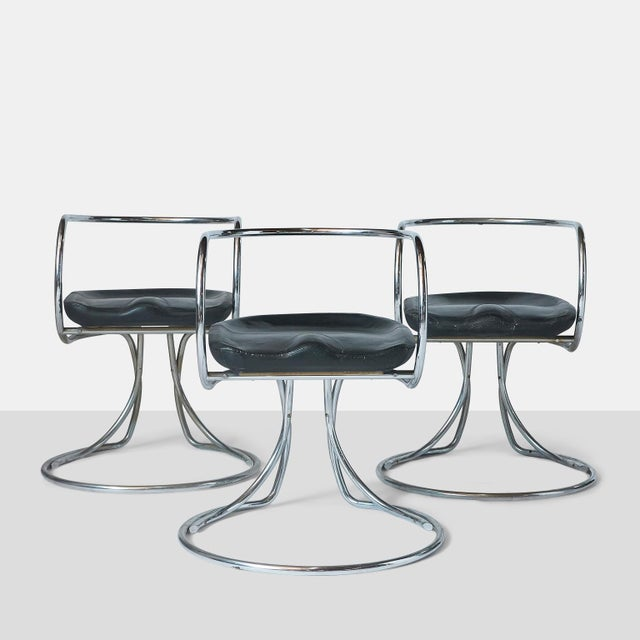 Vladimir Tatlin chairs Very rare group of three dining armchairs in chromed tubular steel with molded foam seat and...