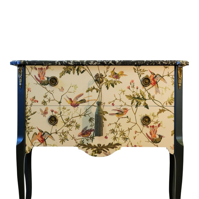 Antique Louis XV style commode which has been restored to the highest standard and a floral pattern applied to the front...