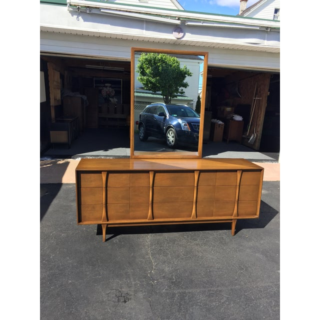 Mid-century dresser with mirror by Red Lion Table Company. Dresser features three smaller drawers on each end with three...