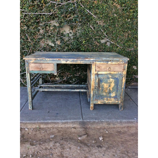 Large and beautifully distressed shabby chic desk with cabinet and drawer. Cool and warm tones throughout this simple and...