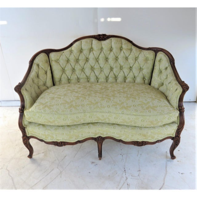 Louis XV Style Settee, carved fruitwood frame , light green tufted upholstery, seat height 19