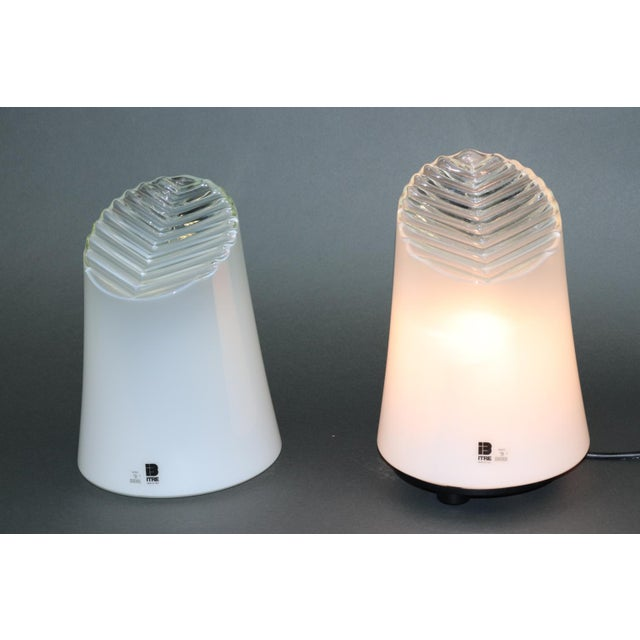 Murano table lamps, hand blown white smoked glass with embossed geometric details. Mounting: black lacquered metal and...