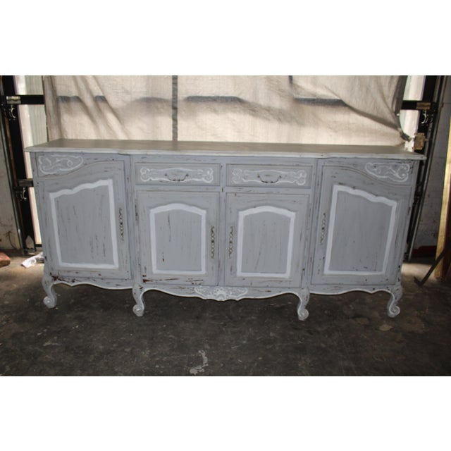 19th Century French large sideboard. Gray and white distressed oak detailing. Chic carvings on legs, corners and doors....