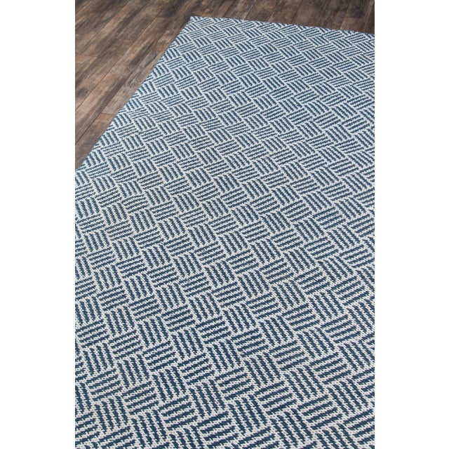 Nautical navy blue tones and an organic inspired pattern make this indoor/outdoor area rug perfect for outfitting a...