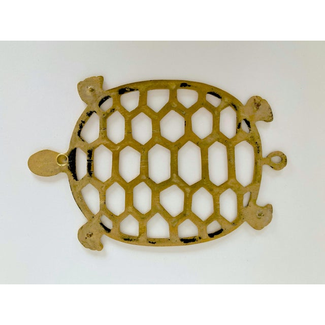 This vintage brass turtle trivet adds a bit of fun and whimsy to your table, use in the kitchen or hang as decor.