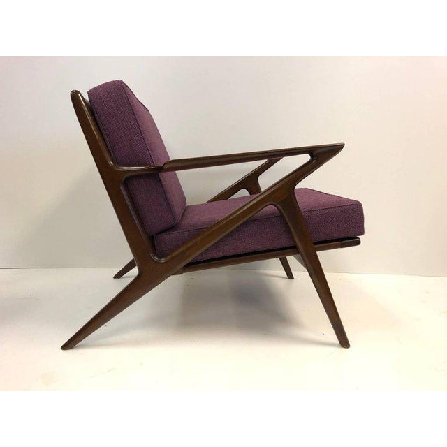 Pair of Z Lounge Chairs by Poul Jensen for Selig. Sculptural wood frames with newly, purple, upholstered cushions.