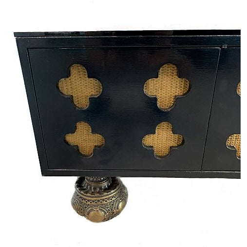 Rare and elegant hand-crafted 1960s Moroccan mahogany low console table. Black lacquered finish with large Moorish...
