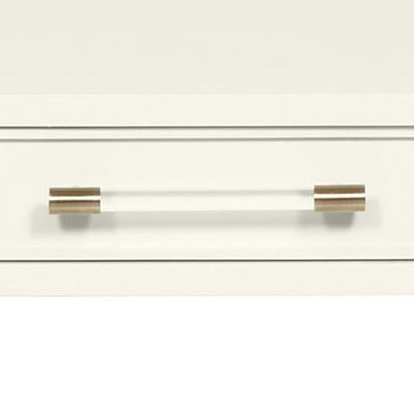 This desk features three drawers resting on an acrylic and satin brass metal leg base.