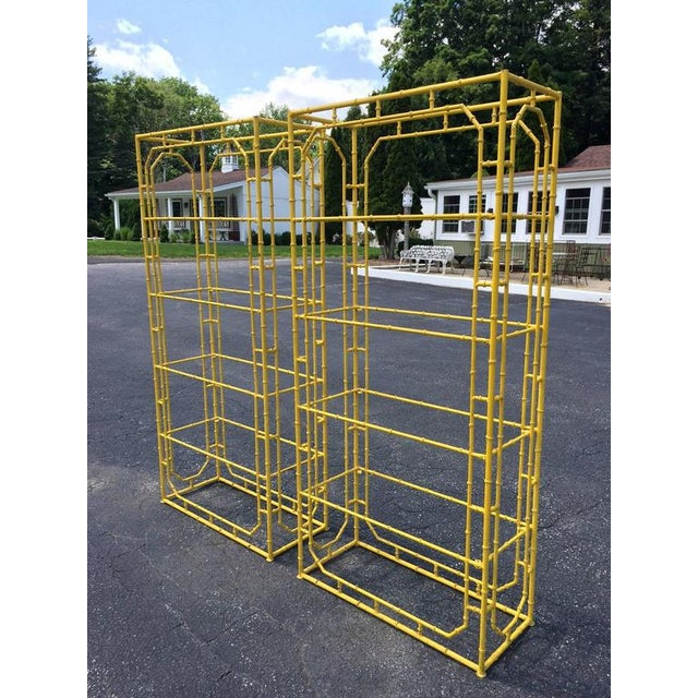 This bright yellow painted pair, can be changed to any color desired. Four large glass shelves allow for ample storage and...
