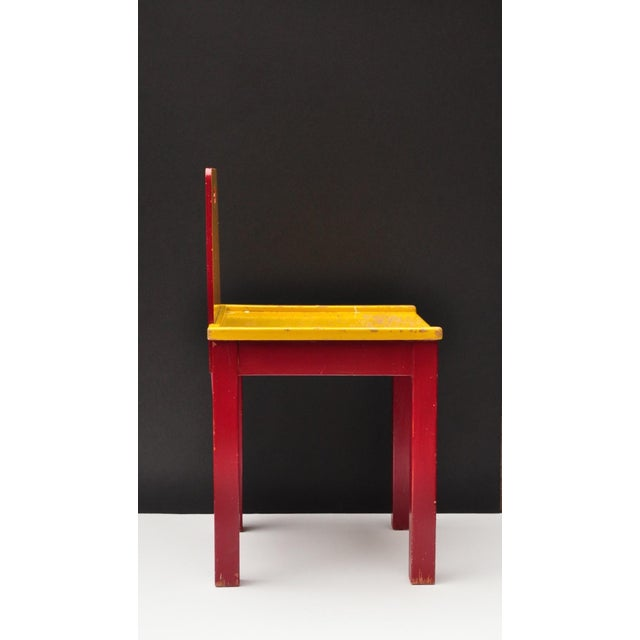 Dynamic child chair retaining the original painted surface. Switzerland 1950s.