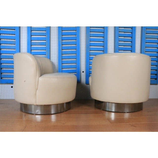 1970s Leather and chrome base chairs styled after Milo Baughman. These chairs are in great condition and have no damages ....