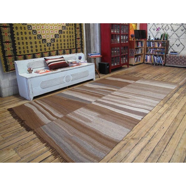 A lovely old Kilim from Southeastern Turkey, woven with nothing but natural brown wool in many rich tonal variations. What...
