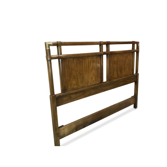 Elegant Campaign style queen size headboard from Drexel's Heritage collection. The gorgeous walnut wood looks very elegant...