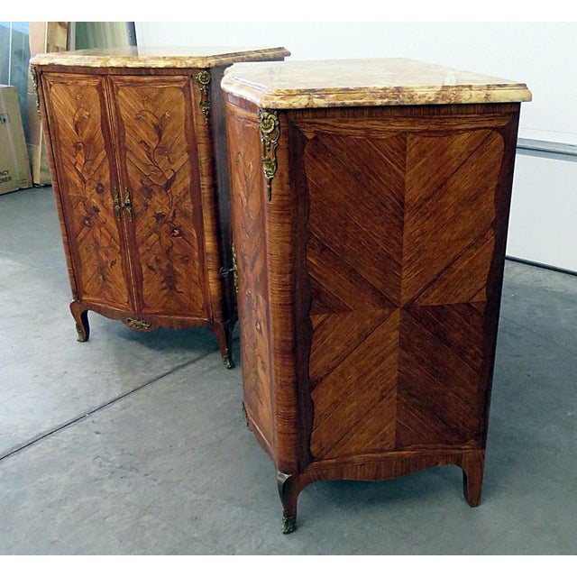 """Pair of Maison Jansen inlaid marble top commodes with bronze mounts. Stamped """"Jansen"""" and """"Made in France"""""""