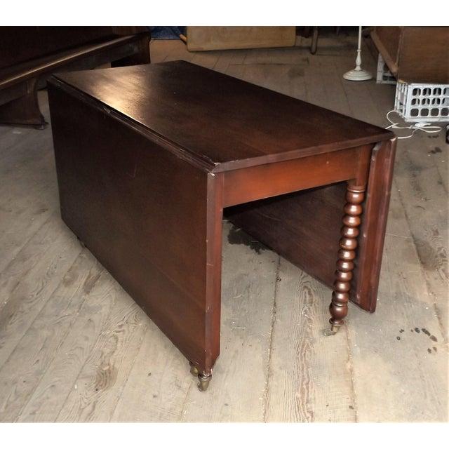 Vintage walnut drop leaf gate leg table chairish vintage walnut drop leaf gate leg table image 2 of 11 watchthetrailerfo
