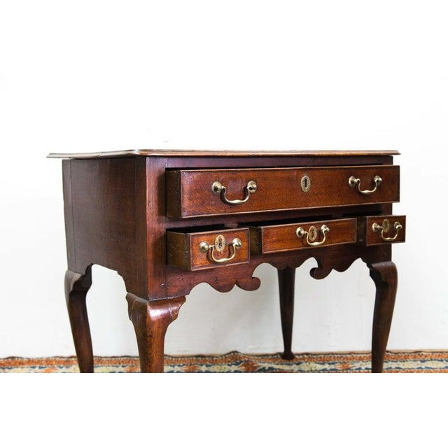 Early 18th Century Four Drawer Dressing Table with Original Brass Hardware and Slipper Feet For Sale - Image 5 of 6