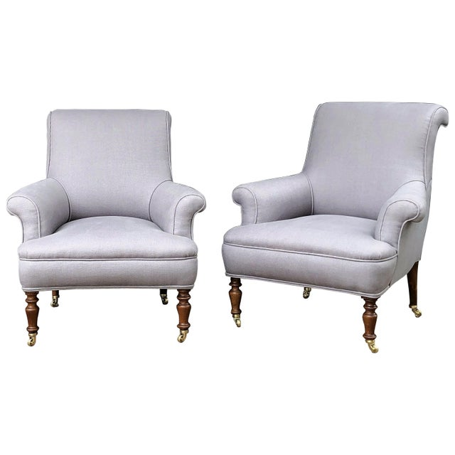 A fine French scroll-back armchair from the 19th century, each chair featuring a comfortable back and seat upholstered in...
