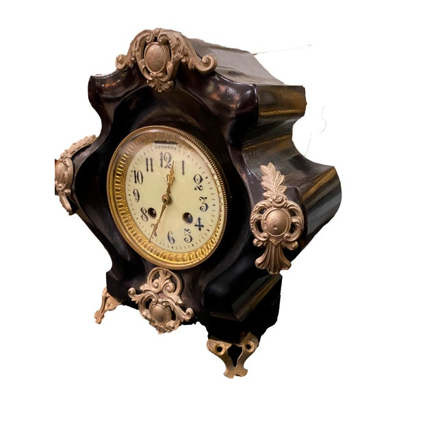 """Antique French black gilded clock. Signed France on back. Has it's key. 9.5"""" Wide x 5"""" Deep x 10.5"""""""