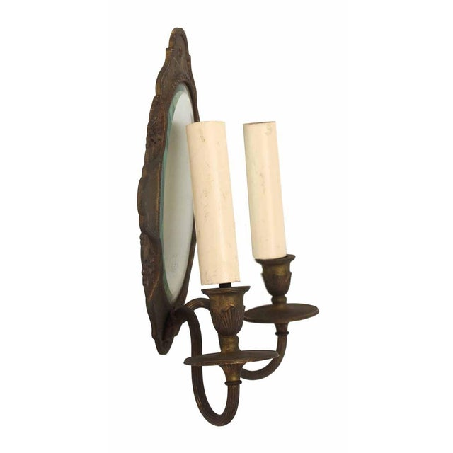Victorian style double arm sconce with beveled mirror inset. Sold as a single. Priced as is.